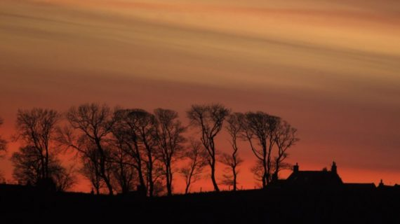 The sun sets behind a farm house near Whitby in Yorkshire. PRESS ASSOCIATION Photo. Picture date: Sunday December 3, 2017. Photo credit should read: Danny Lawson/PA Wire
